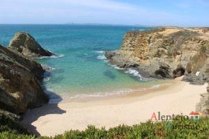Baía, praia e cabo